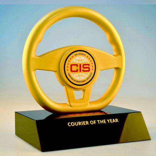 Bespoke DHL aluminium steering wheel award by Etchcraft