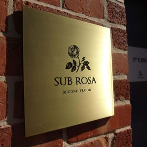 Brass signage by Etchcraft